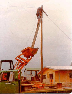 pole-wire-service-man.jpg